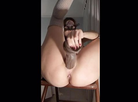Latina with huge tits jams a dildo in her pussy